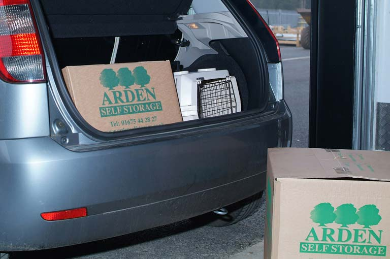 an image of a customer's care loaded with Arden Self Storage-branded boxes