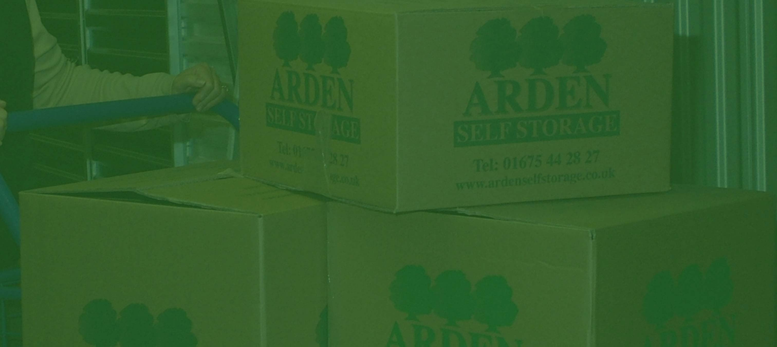 an image of Arden Self Storage boxes with a green hue for the banner