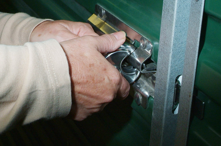 a close up image of a padlock being locked