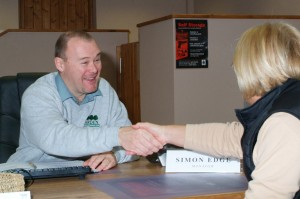 an image of the Arden Self Storage manager meeting and greeting a new customer