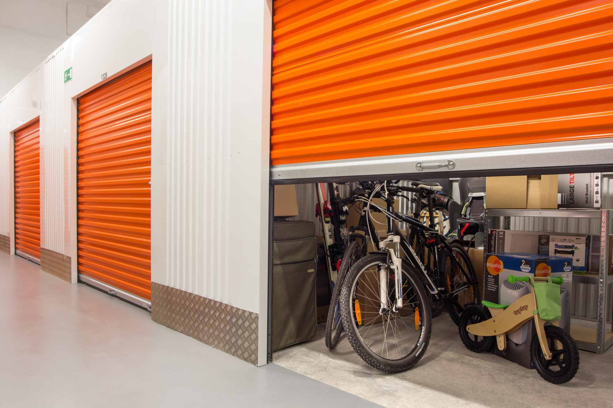 an image of a half open self storage unit