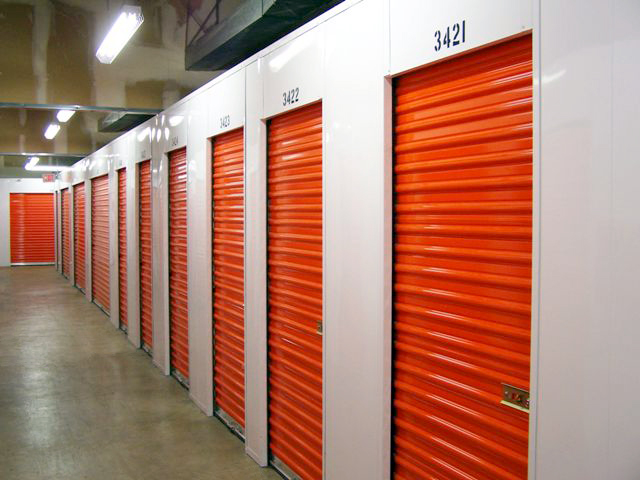 an image of a row of self storage units