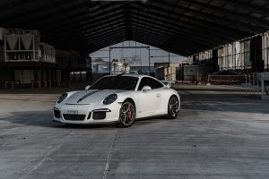 image of a white porsche in a garage