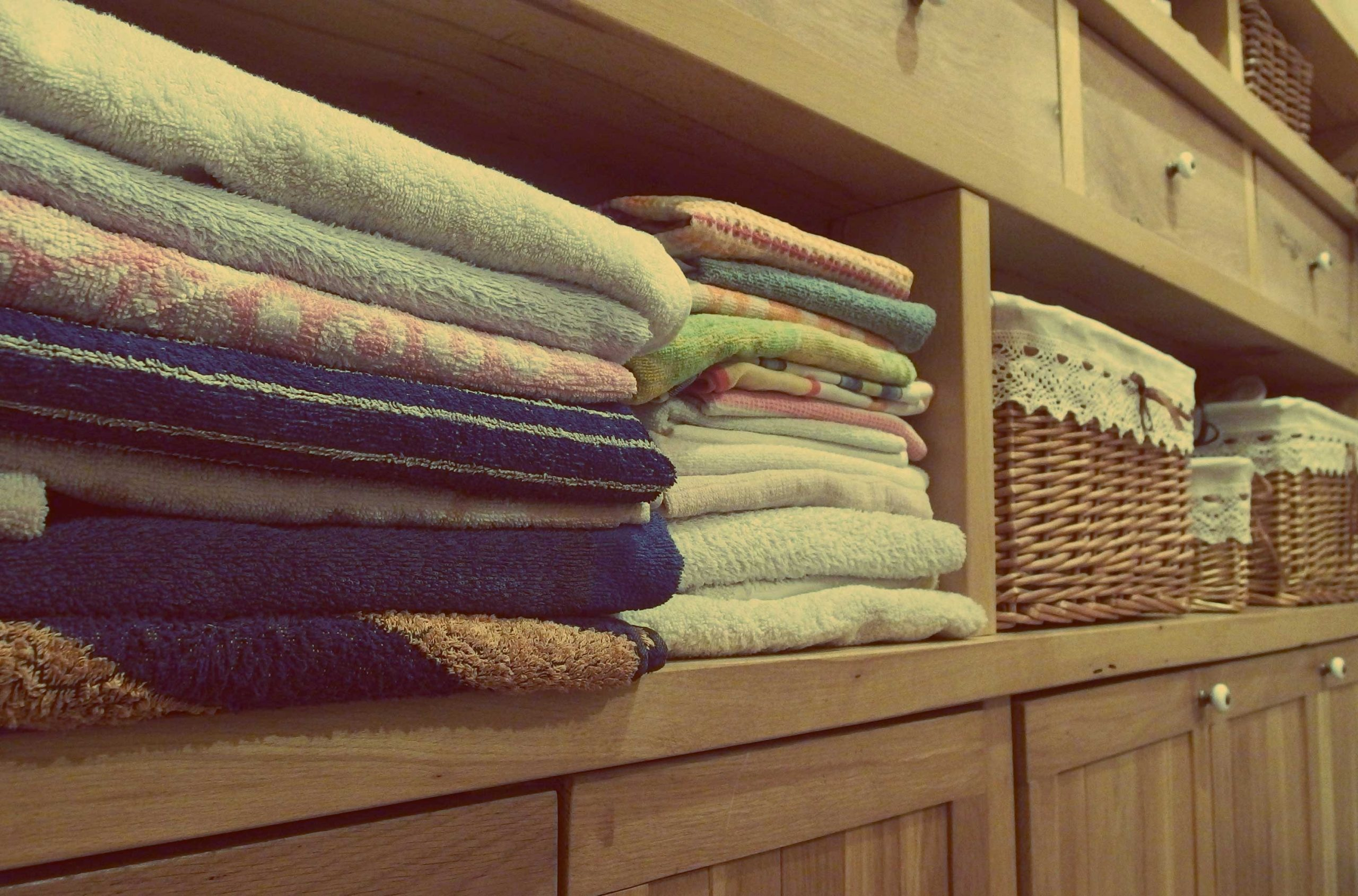 image of bathroom towels organised neatly