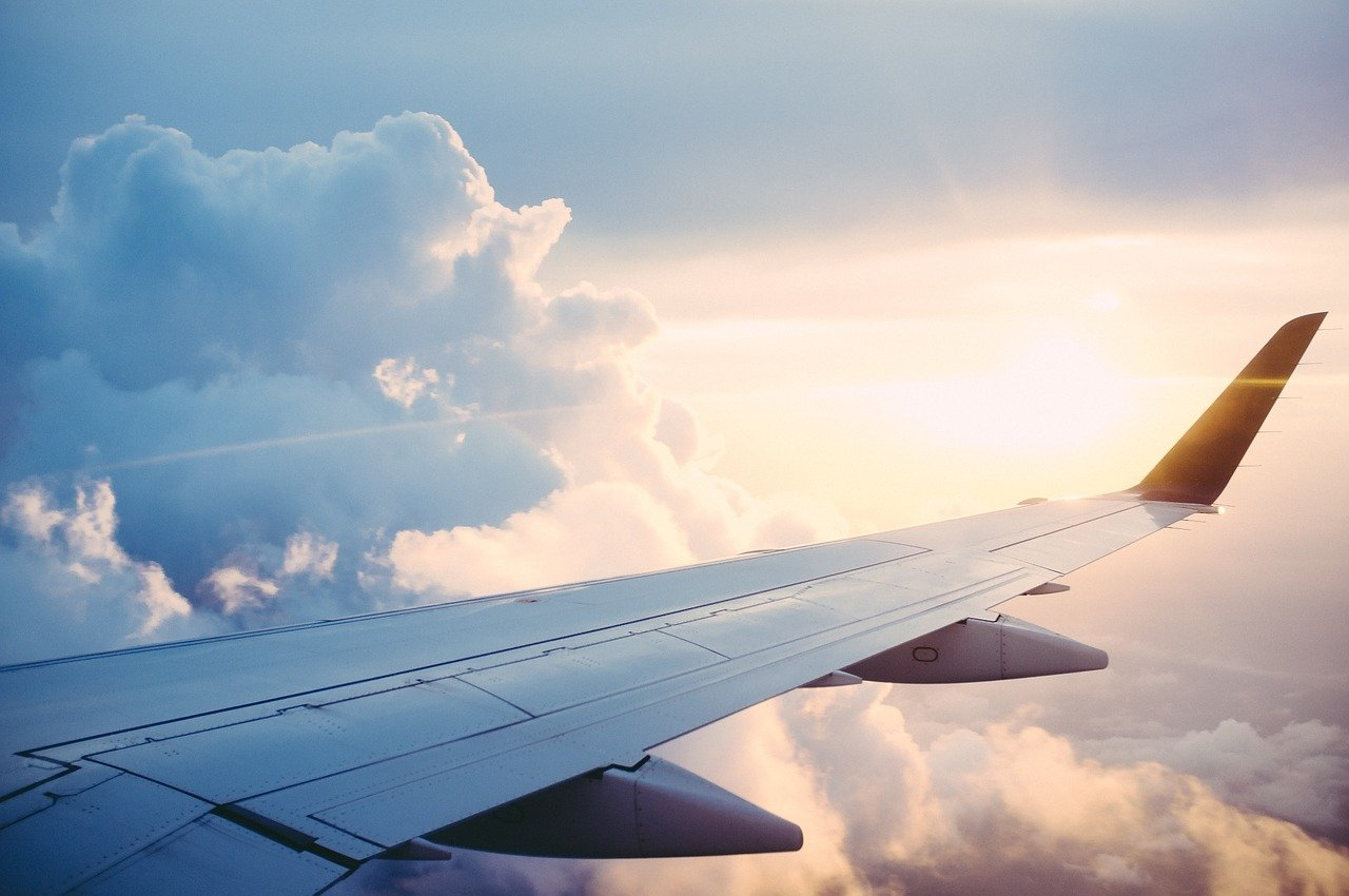 image of the wing of a plane in flight
